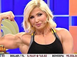 Girl Flexing For Tv Show Host