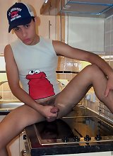 Young twink gets horned when he jerks off at empty kitchen